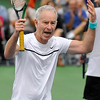Brad Davis/The Register-Herald<br /> Tennis legend John McEnroe tries to draw some energy from the many fans in attendance as he competes in the Greenbrier Champions Tennis Classic Sunday afternoon in White Sulphur Springs.