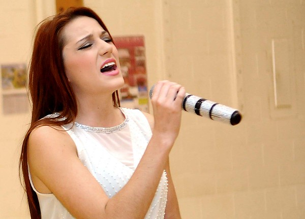 Rick Barbero/The Register-Herald<br /> Former Crescent student and local singer, Jenna Athur, performs during Crescent Elementary School on Crescent Road in Beckley celebrate for being named one of the best schools in the state. Crescent was only one of nine out of seven hundred elementary schools in WV to receive the School of Excellence award.