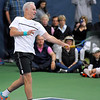 Brad Davis/The Register-Herald<br /> Tennis legend John McEnroe competes against former pro Jim Courier at the Greenbrier Champions Tennis Classic Sunday afternoon in White Sulphur Springs.