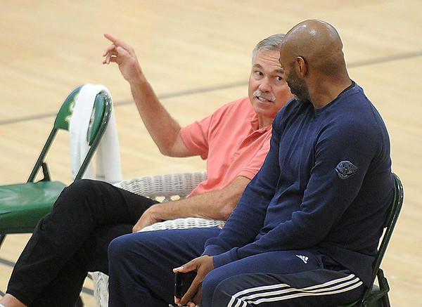 Rick Barbero/The Register-Herald<br /> Former NBA coach, Mike D'antoni. left, and Dell Demp, general manager Pelicans, speak during the New Orleans Pelicans training camp held at The Greenbrier Resort in White Sulphur Springs Tuesday afternoon.