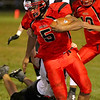 Brad Davis/The Register-Herald<br /> Oak Hill quarterback Deonte Scruggs carries the ball during the Red Devils' homecoming loss to the Pioneers Friday night.