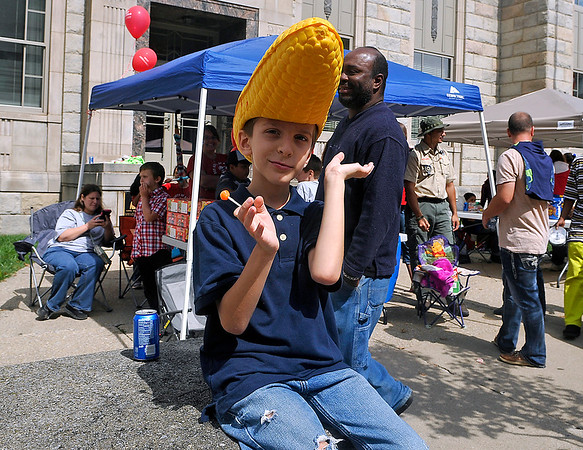 Brad Davis/The Register-Herald<br /> Sporting the perfect hat for the job, eight-year-old cub scout and expert popcorn salesman Tyler Vines strikes a quick pose as he sits in front their gazebo announcing to the masses that popcorn is for sale there during the Kids Classic Festival Saturday afternoon. He was there with fellow members of his Troop 16 out of Shady Spring trying to raise a little extra cash.