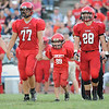 Rick Barbero/The Register-Herald<br /> Jaxson Workman, 6, of Bolt, number 99, walks out with the Liberty team captains, from left, Brenden Honaker, Michael Talley, Christian Whittaker and Hunter Wright for the coin toss with Summers Co. at Liberty High School Friday Night.