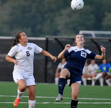 Brad Davis/The Register-Herald<br /> Woodrow Wilson's Rachel Quattrone battles for possession with Spring Valley's Lindsay Fuller Thursday night at the YMCA Paul Cline Memorial Sports Complex.