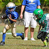 Brad Davis/The Register-Herald<br /> Mustangs player Javontae Wynes, left, tries to get away from pursuing Fayetteville Pirates defender Arnie Sharp during a JVC (ages five and six) little league football matchup Saturday afternoon in Mount Hope.