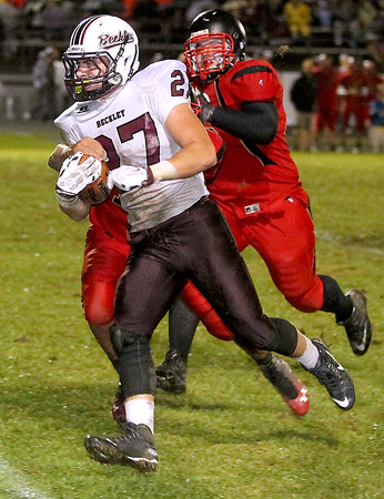 Brad Davis/The Register-Herald<br /> Woodrow Wilson running back Trey Cole gets through the Red Devils' defense for a big gain Friday night in Oak Hill.
