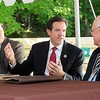 Rick Barbero/The Register-Herald<br /> Senator Evan Jenkins, center, speaks with , John Crites II, president Allegheny Wood Products, left, and John Crites Sr., founder Allegheny phoducts, during a dedication ceremony held at the plant in Smoot.