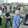 Rick Barbero/The Register-Herald<br /> Crowd lines up to touch the steel from the World Trade Center during a 9/11 ceremony held at Word Park on Neville Street in Beckley Friday morning.