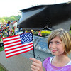 Rick Barbero/The Register-Herald<br /> Kayla Hodges, 9, daughter of Chris and Jordan Hodges, of Beckley, holds up the American flag during a 9/11 ceremony held at Word Park on Neville Street in Beckley Friday morning.