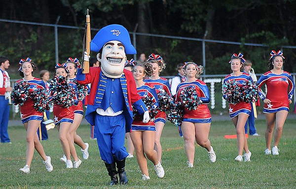 Rick Barbero/The Register-Herald<br /> Midland Trail mascot and cheerleaders run on the field before game against Meadow Bridge Friday night at Midland Trail High School in Hico.