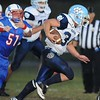 Rick Barbero/The Register-Herald<br /> Shane Harless, of Meadow Bridge, right, breaks away from Kyle Keeney, 51, of Midland Trail Friday night during game at Midland Trail High School in Hico.