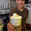 Brad Davis/The Register-Herald<br /> Kevin Traube, owner of The Chocolate Moose, proudly shows off his coffee shop's version of a pumpkin spice latte during the first day of fall Wednesday evening at his Harper Road location in Beckley. Even before the official change of seasons, establishments everywhere were already offering pumpkin spice items of all types from pastries to gourmet coffee beverages in anticipation of patrons craving a little taste of Autumn.