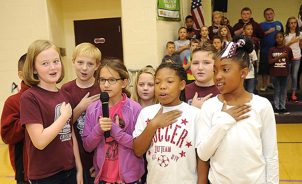 Rick Barbero/The Register-Herald<br /> Crescent Elementary School on Crescent Road in Beckley celebrated for being named one of the best schools in the state. Crescent was only one of nine out of seven hundred elementary schools in WV to receive the School of Excellence award. Student council members start off the program with the pledge of allegiance.