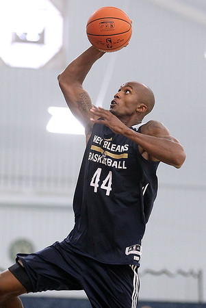 Brad Davis/The Register-Herald<br /> Forward Dante Cunningham soars to the basket during New Orleans Pelicans training camp Wednesday afternoon in White Sulphur Springs.