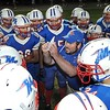 Rick Barbero/The Register-Herald<br /> Midland Trail getting some instructions after the first quarter during game against Meadow Bridge Friday night at Midland Trail High School in Hico.