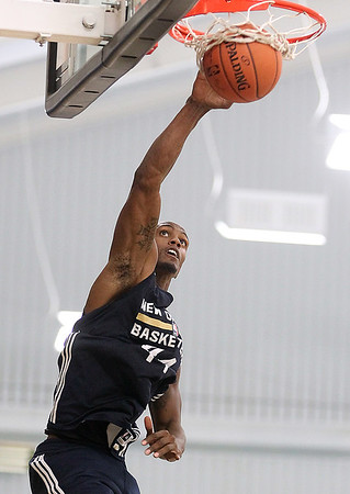 Brad Davis/The Register-Herald<br /> Forward Dante Cunningham finishes a drive to the basket with a dunk during New Orleans Pelicans training camp Wednesday afternoon in White Sulphur Springs.
