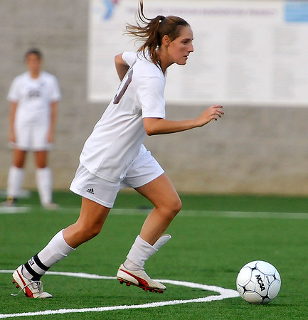 Brad Davis/The Register-Herald<br /> Woodrow Wilson's Rebekah Cook dribbles up the field against Spring Valley Thursday night at the YMCA Paul Cline Memorial Sports Complex.
