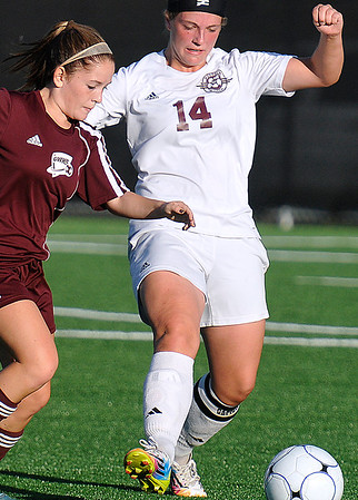 Brad Davis/The Register-Herald<br /> Woodrow Wilson defender Mikayla Akers, the Flying Eagles' lone goal scorer for the match, battles for possession with George Washington's Hattie Davis Thursday night at the YMCA Paul Cline Memorial Sports Complex.