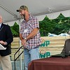 Rick Barbero/The Register-Herald<br /> John Crites Sr., founder Allegheny products, left, presented Stanley Harper with a $1000. check for his 40 years of employment with the company during a dedication ceremony held at the plant in Smoot Monday morning. watching on far right,  John Crites II, president Allegheny Wood Products