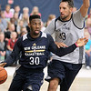 Brad Davis/The Register-Herald<br /> Guard Norris Cole, left, looks for an open teammate as forward Ryan Anderson defends during New Orleans Pelicans training camp Wednesday afternoon in White Sulphur Springs.