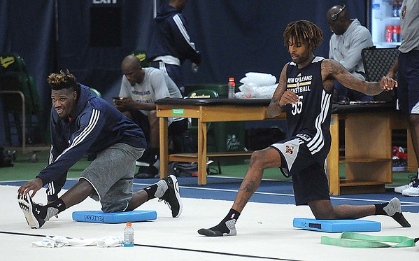 Rick Barbero/The Register-Herald<br /> Players stretching during the New Orleans Pelicans training camp held at The Greenbrier Resort in White Sulphur Springs Tuesday afternoon.