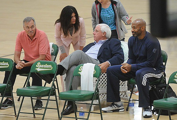 Rick Barbero/The Register-Herald<br /> Former NBA coach, Mike D'antoni. left, Jim Justice, owner The Greenbrier Resort and Dell Demp, general manager Pelicans, watch the New Orleans Pelicans basketball team practice during training camp held at The Greenbrier Resort in White Sulphur Springs Tuesday afternoon.