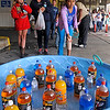 Brad Davis/The Register-Herald<br /> 11-year-old Cameryn McDowell tries to earn herself something to drink at a ring toss game during the Kids Classic Festival Saturday afternoon.