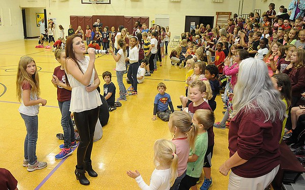 Rick Barbero/The Register-Herald<br /> Former Crescent student and local singer, Jenna Athur, performs during Crescent Elementary School on Crescent Road in Beckley celebrating for being named one of the best schools in the state. Crescent was only one of nine out of seven hundred elementary schools in WV to receive the School of Excellence award.