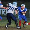 Rick Barbero/The Register-Herald<br /> Colby Martin, 70, of Meadow Bridge, getting ready to tackle, Thomas Ferris, of Midland Trail during game Friday night at Midland Trail High School in Hico.
