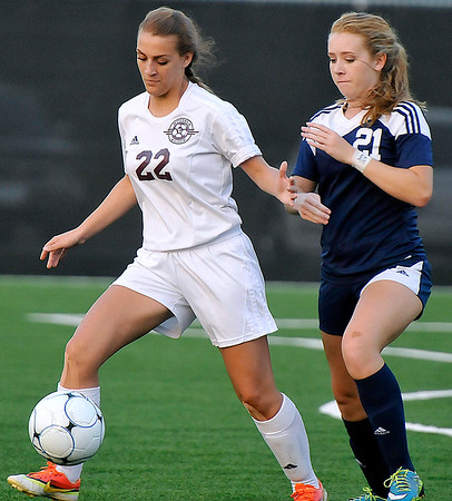 Brad Davis/The Register-Herald<br /> Woodrow Wilson's Leah England battles for possession with Spring Valley's Morgan Adkins Thursday night at the YMCA Paul Cline Memorial Sports Complex.
