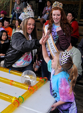 Brad Davis/The Register-Herald<br /> Little Miss Beckley Kids Classic Patience Meadows (lower right), 6, gets a high-five from Miss Beckley-Raleigh County Taylor Stewart, left, after winning a heat in the Kids Classic Hamster Races Sunday afternoon at the Youth Museum.