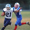 Rick Barbero/The Register-Herald<br /> Chris Sims, left, of Meadow Bridge, runs by Hunter Adkins, of Midland Trail during game Friday night at Midland Trail High School in Hico.