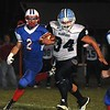 Rick Barbero/The Register-Herald<br /> Shane Harless, right, of Meadow Bridge, breaks away from Hunter Adkins, of Midland Trail, during game Friday night at Midland Trail High School in Hico.