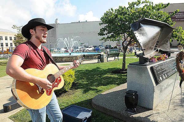 Rick Barbero/The Register-Herald<br /> Cody Wickline singing during a 9/11 ceremony held at Word Park on Neville Street in Beckley Friday morning.