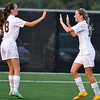 Brad Davis/The Register-Herald<br /> Woodrow Wilson's Kailey Varney, right, is congratulated by teammate Breanna Cecil after scoring the Flying Eagles' second goal of the first half against Spring Valley Thursday night at the YMCA Paul Cline Memorial Sports Complex.