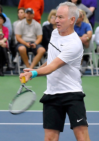 Brad Davis/The Register-Herald<br /> Tennis legend John McEnroe competes in doubles against Jim Courier and James Blake at the Greenbrier Champions Tennis Classic Sunday afternoon in White Sulphur Springs.