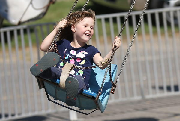 Chris Jackson/The Register-Herald<br /> Madalyn Cook, 6, from Brenton, rides a ride during the annual Labor Day parade and carnival in Pineville  on Monday.