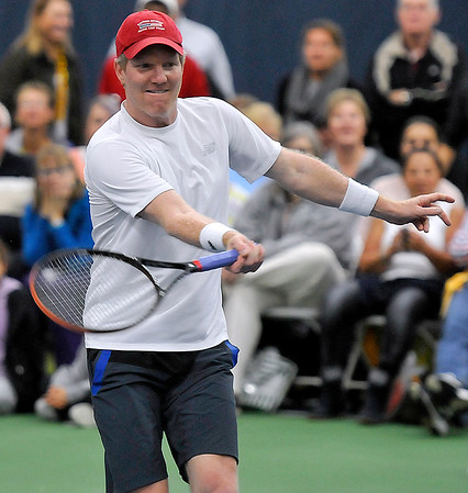 Brad Davis/The Register-Herald<br /> Former pro Jim Courier competes in a doubles match against John McEnroe and Pete Sampras at the Greenbrier Champions Tennis Classic Sunday afternoon in White Sulphur Springs.