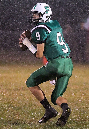 Brad Davis/The Register-Herald<br /> Fayetteville's Jordan Dempsey drops back to throw against Man Friday night.