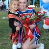Rick Barbero/The Register-Herald<br /> Anslee Maynor, 4, left, was crowned as Little Miss Patriot and is getting hugged by her escort Stacy Irgram before the Midland Trail vs Meadow Bridge game Friday night at Midland Trail High School in Hico.