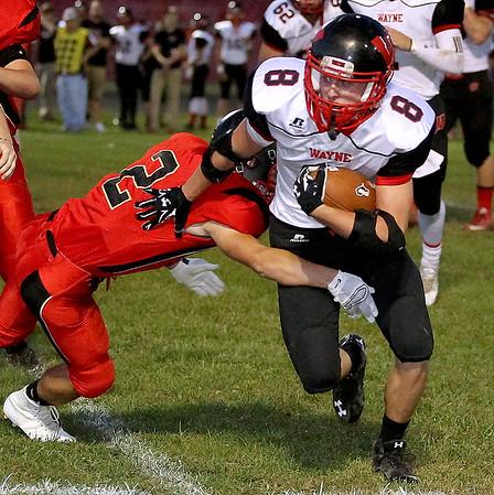 Brad Davis/The Register-Herald<br /> Wayne running back Kade Sebastian carries the ball as Oak Hill's Dakota Shreve tries to bring him down Friday night.
