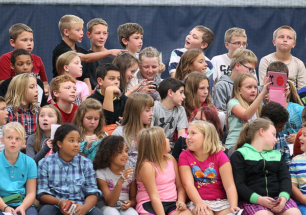 Brad Davis/The Register-Herald<br /> Lucky youngsters on a field trip take in the action during New Orleans Pelicans training camp Wednesday afternoon in White Sulphur Springs.