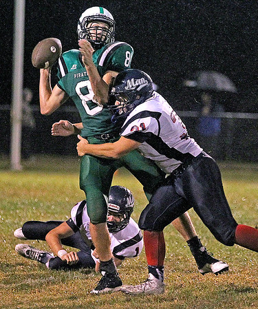 Brad Davis/The Register-Herald<br /> Fayetteville's Dalton Dempsey is hit before he can throw Friday night in Fayetteville.