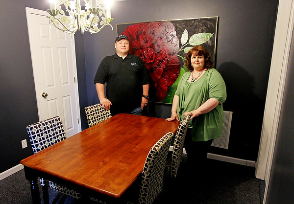 "Ray King, left, of Ark Builders, and April Lewis, of Lewis Interiors, during their open house for their new location at 204 N. Eisenhower Dr. in Beckley. Lewis said this is something really different, adding that ""the customer gets everything from designing to building."" (Chris Jackson/The Register-Herald)"