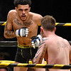(Brad Davis/The Register-Herald) Beckley's Juwan Rowe, left, takes on Cody Null in Original Toughman's first ever MMA bout Saturday at the Beckley-Raleigh County Convention Center.