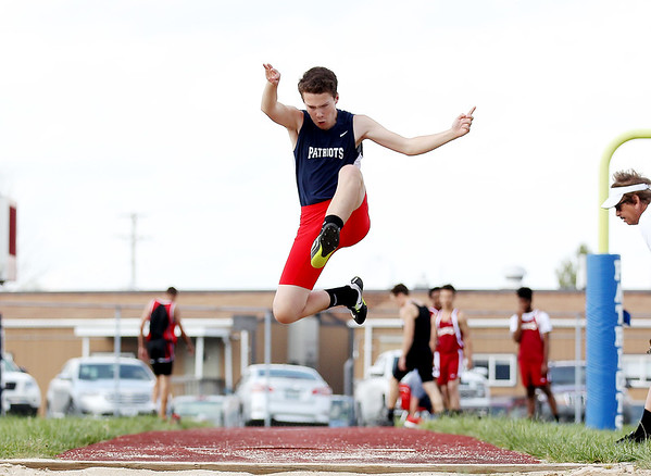 Independence's Brent Morris competes in the long jump event during a track meet at Independence in Coal City on Tuesday. (Chris Jackson/The Register-HErald)