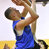 (Brad Davis/The Register-Herald) Shady Elite's Isiah Valentine drives and scores against WV Warriors (Charleston) during the 7th grade Spring Fling Tournament championship game Sunday afternoon at Shady Spring High School. WV Warriors went on to win the game.