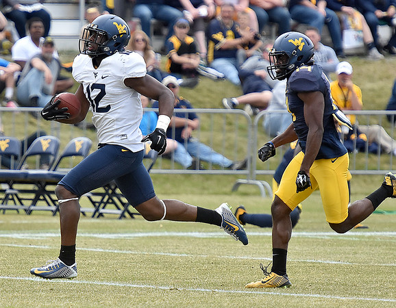 (Brad Davis/The Register-Herald) West Virginia receiver Gary Jennings, left, gets loose for a touchdown during the Mountaineers' Gold-Blue Spring football game Saturday afternoon at The Greenbrier.