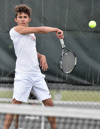 (Brad Davis/The Register-Herald) Woodrow Wilson's Ishaq Jafary plays in a doubles match against Bluefield Wednesday afternoon in Beckley.