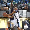Jeremy Thompson, of Bluefield, playing for Jan-Care AA all-stars goes in for a layup against, Nene Kiameso, of C. Adam Toney Class A all-stars, during the Little General Scott Brown Classic held at the Beckley-Raleigh County Convention Center Saturday evening.<br /> (Rick Barbero/The Register-Herald)